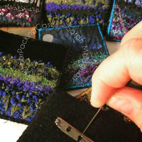 Stitching brooches